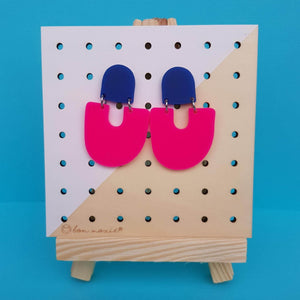 Moops statement earrings, two drops galaxy blue and hot pink.