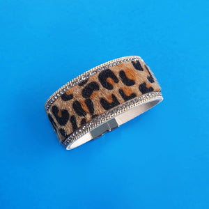 Animal print wrap bracelet with sparkly edging.