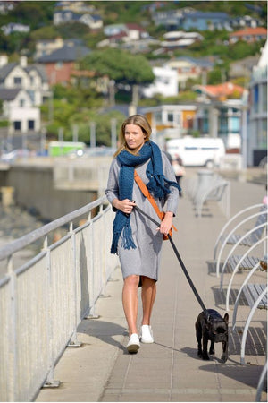 Woman walking dog wearing Trailblazer Scarf Peacock