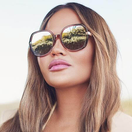 Model wearing Quay Gold Dust Sunnies close up