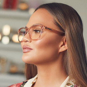 Side profile of woman's face wearing Hardwire blue light glasses in Champagne coloured frames.