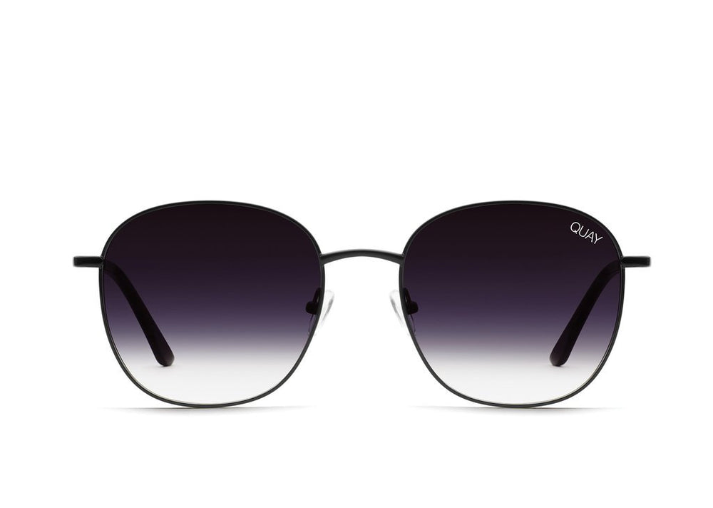Front view on white background of Quay Jezabell sunnies with black frames and faded lenses