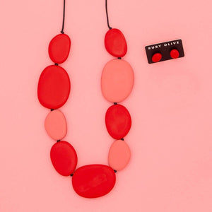Rocco Long Flat Pebble Necklace Melon & red with matching earrings