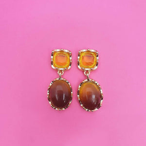 Sofia earrings have two drops with gold tones.