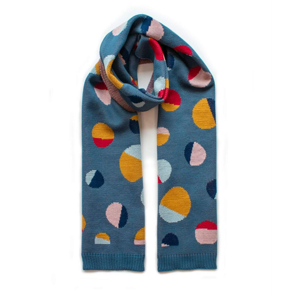 Warm scarf, with coloured spots in slate, poppy and mustard.