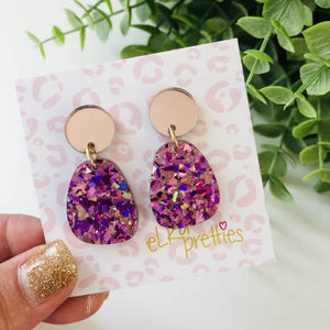 Stella earrings with two drops, the first is in rose gold and the second in a shattered fuchsia glitter