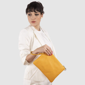 Model wearing the yellow Tully as a wristlet.