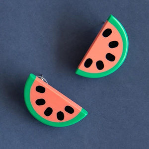 Watermelon earring on blue background