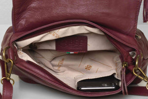 Close up and inside view of the plum leather Vasarino bag.