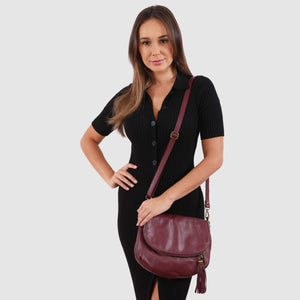 Model wearing the leather plum Vasarino bag.