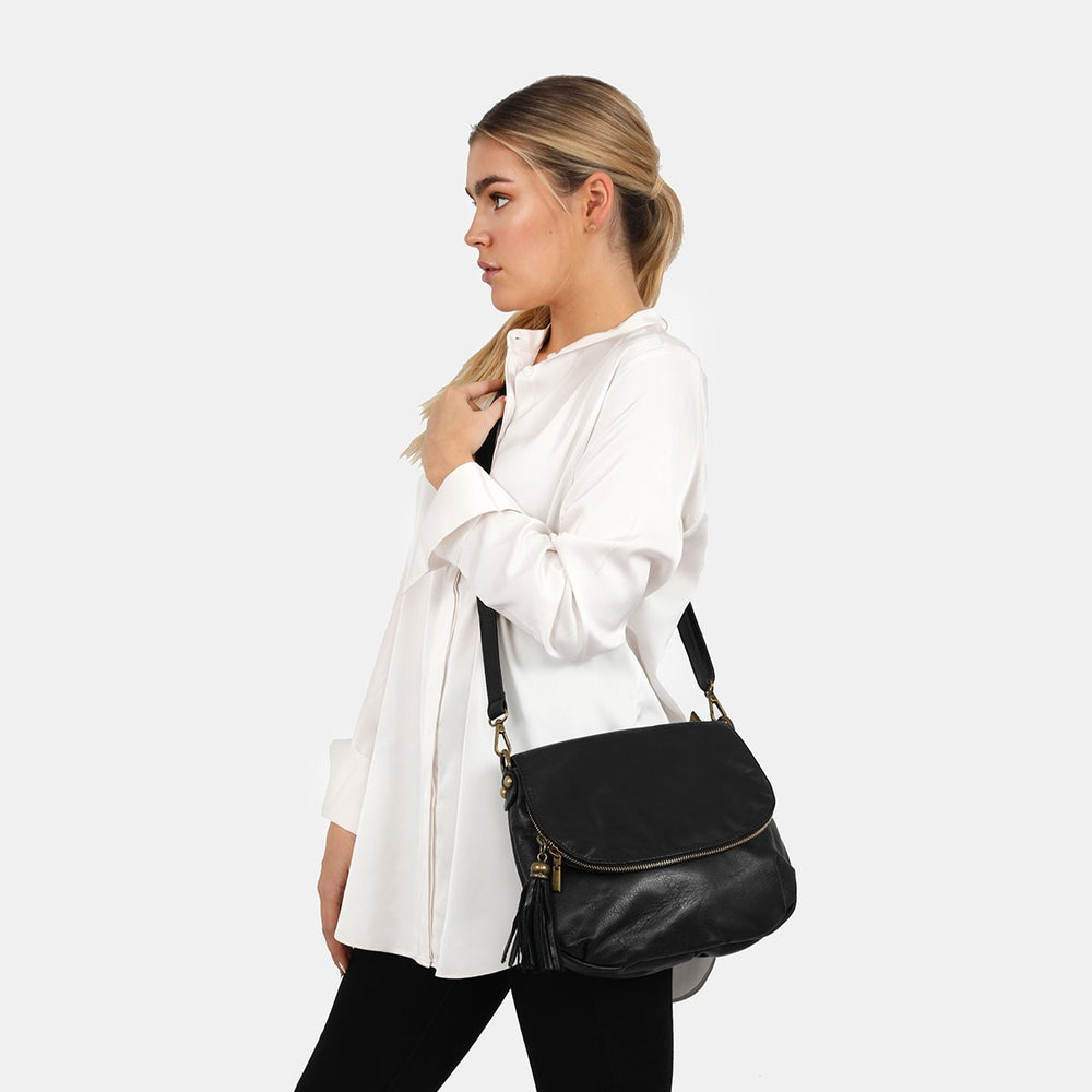 Woman wearing vasarino black bag