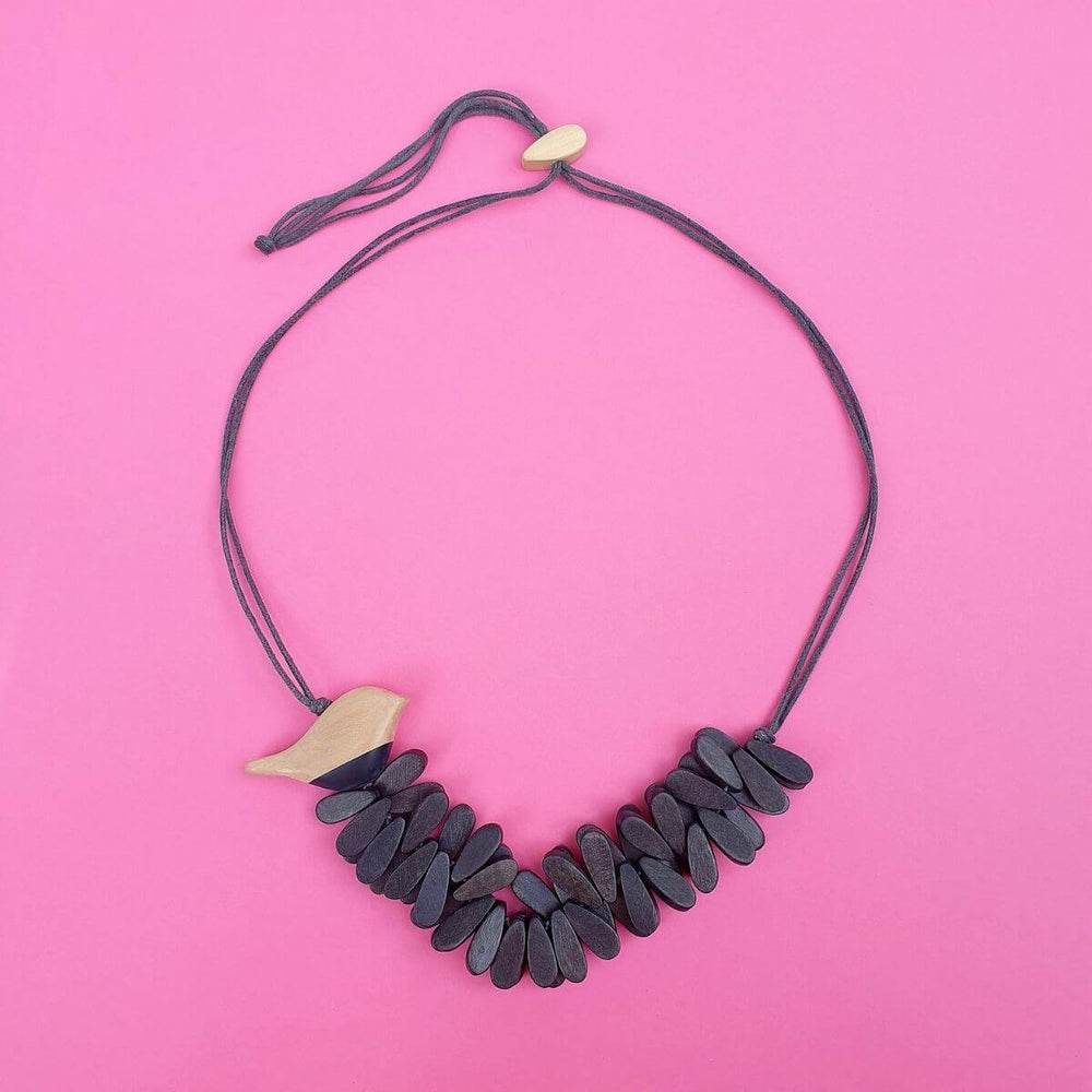 Well Rounded Birdie Necklace on a pink background