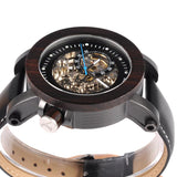 black wood watch with automatic movement