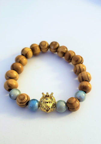 Wooden Beaded Bracelet w/crowned gold Lion Head & Lt. Blue Beads