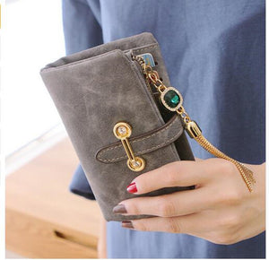 Leather purse with tassel