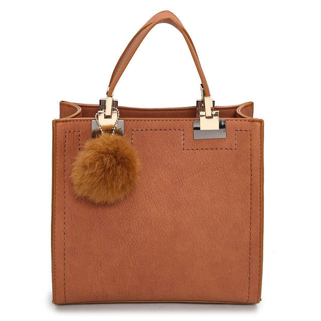 Winter tote with faux fur ball