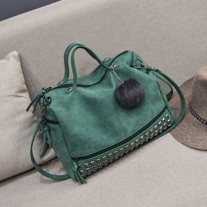Leather rivet tote with faux fur ball