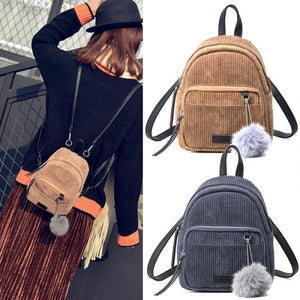 Small corduroy backpack with pomp pom