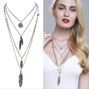 Silver multi layered feather necklace