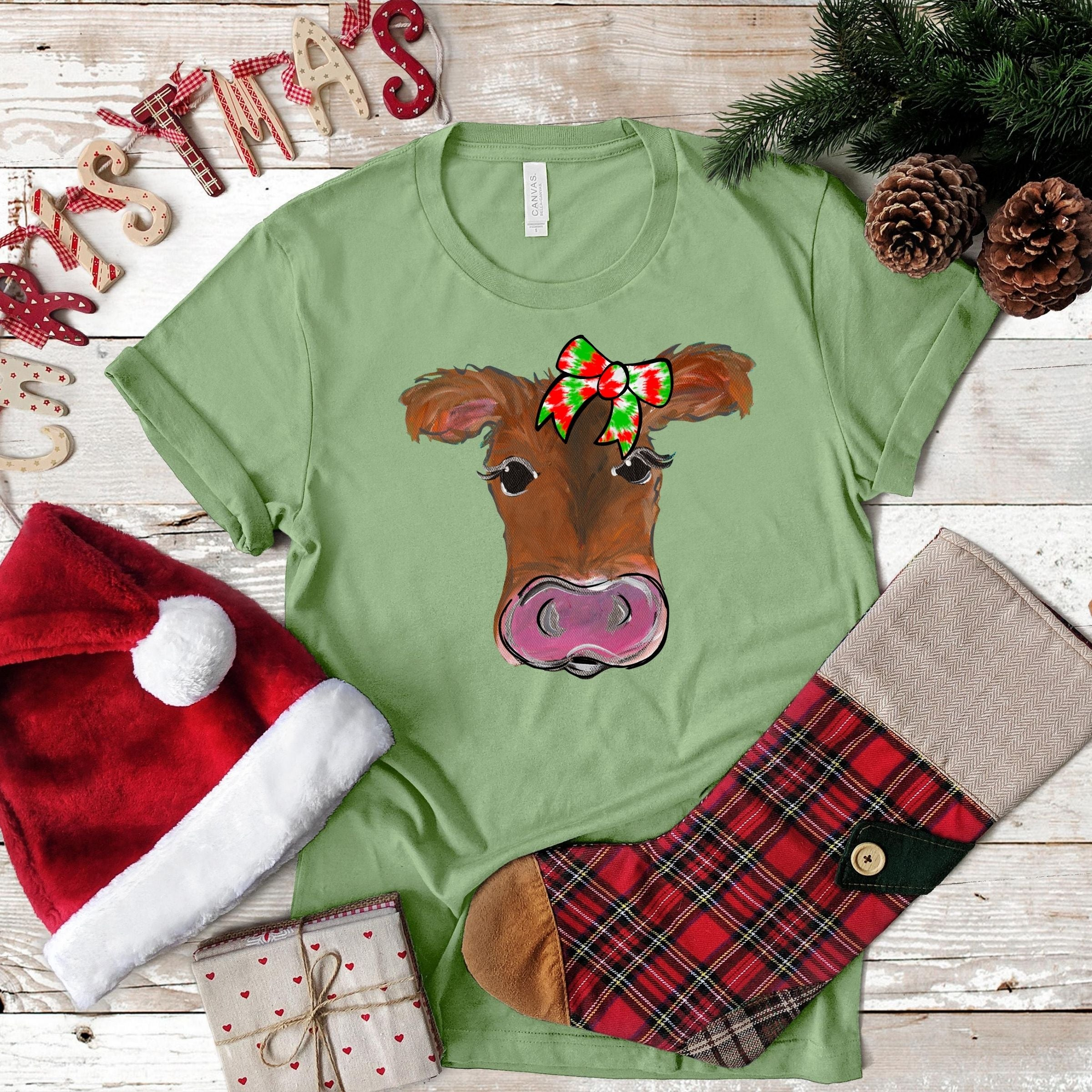 S -Cow With Tie Dye Christmas Bow Heather Green-Seasonal-Shop-Wholesale-Womens-Boutique-Custom-Graphic-Tees-Branding-Gifts