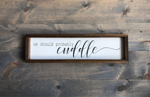 We should probably cuddle | wood sign