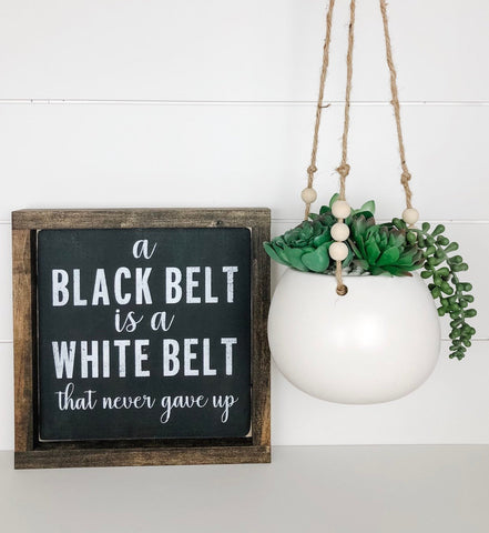 A black belt is a white belt that never gave up | wood sign