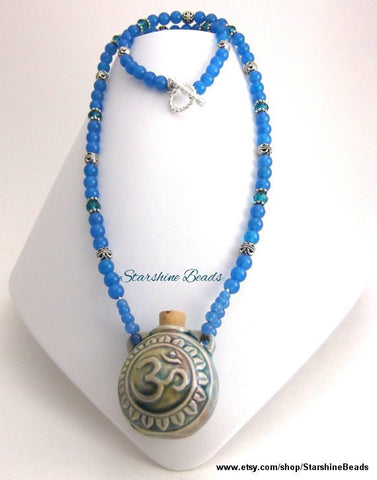 A Bottle of Serenity Blue Onyx Om Raku Bottle Necklace