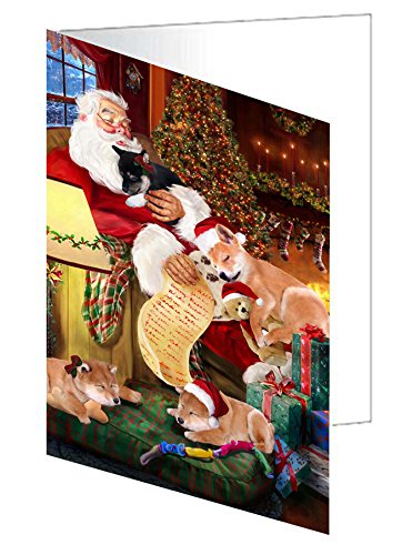 Shiba Inu Dog and Puppies Sleeping with Santa Greeting Card