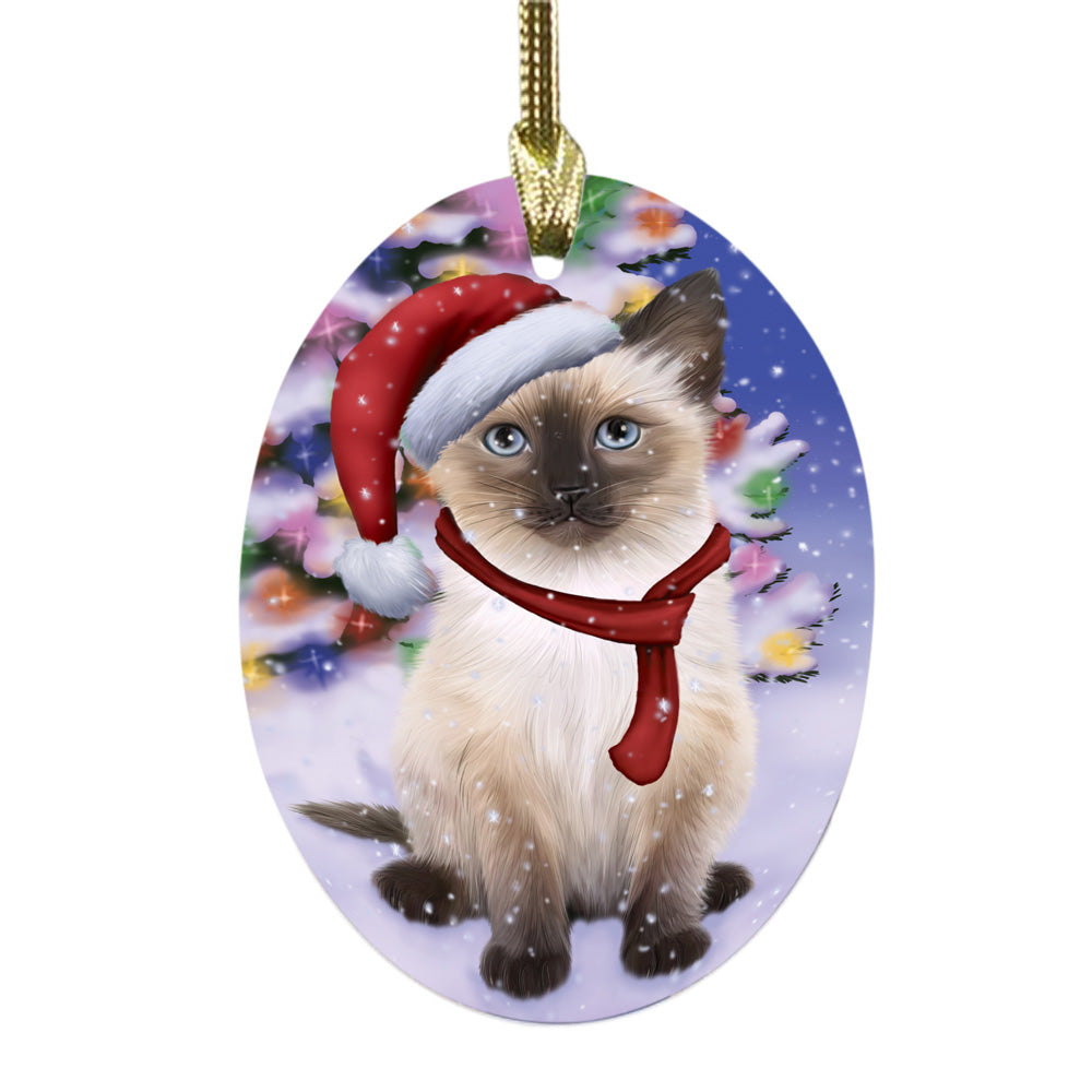 Winterland Wonderland Siamese Cat In Christmas Holiday Scenic Background Oval Glass Christmas Ornament OGOR49641