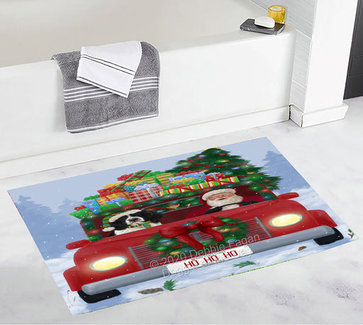 Christmas Honk Honk Red Truck Here Comes with Santa and Springer Spaniel Dog Bath Mat BRUG53878
