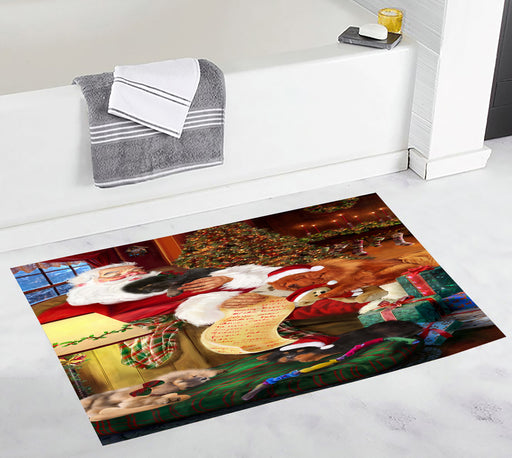 Santa Sleeping with Tibetan Mastiff Dogs Bath Mat