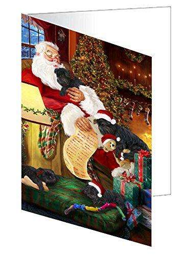 Affenpinscher Dog and Puppies Sleeping with Santa Greeting Card