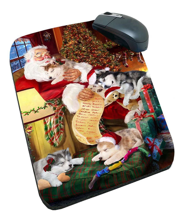 Alaskan Malamute Dog and Puppies Sleeping with Santa Mousepad