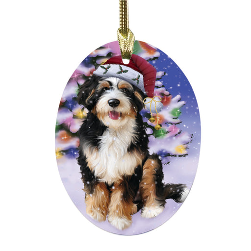 Winterland Wonderland Bernedoodle Dog In Christmas Holiday Scenic Background Oval Glass Christmas Ornament OGOR49516