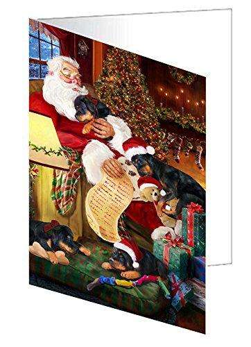 Rottweiler Dog and Puppies Sleeping with Santa Greeting Card