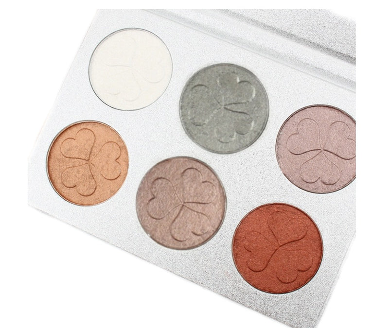 Our multipurpose Contour Bronze and Highlight Palette is an all in one palette that features everything you need to to glam it up! Add depth and dimension to your face and highlight those special areas. Unlike traditional bronzing powders, this palette is loaded with a unique selection of shades that capture the true hues of shadow and light that impart a soft luminosity to amplify dimension, so you can effortlessly sculpt, chisel, shape, and slenderize your features for enhanced definition.
