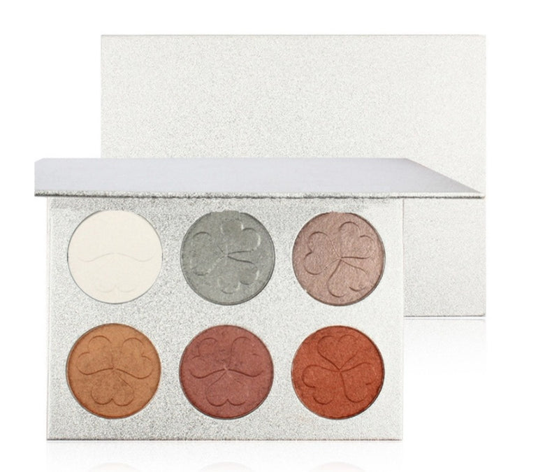 Our multipurpose Contour Bronze and Highlight Palette is an all in one palette that features everything you need to to glam it up! Add depth and dimension to your face and highlight those special areas. Unlike traditional bronzing powders, this palette is loaded with a unique selection of shades that capture the true hues of shadow and light that impart a soft luminosity to amplify dimension, so you can effortlessly sculpt, chisel, shape, and slenderize your features for enhanced definition.     Can be hot