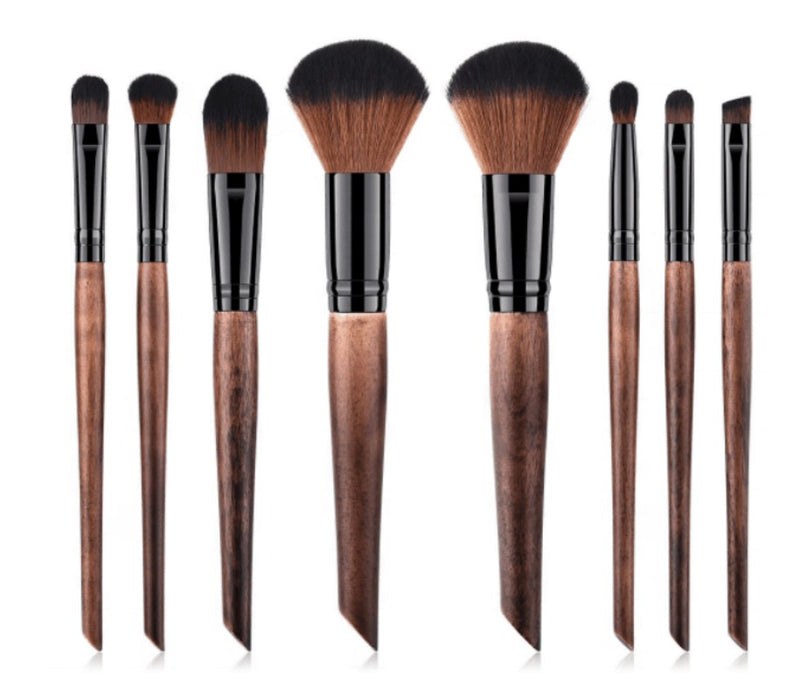 Our gorgeous 8 pc Crafted Wood Handle Makeup Brush Set will ensure you have a brush for every makeup need. An 8 Piece Brush Set, a complete collection of essential face and eye brushes that make it easy to sweep, smooth, smudge and highlight. The professional quality brushes are designed with sleek, chic wood handles and durable, densely packed synthetic bristles. Ideal for use with liquids, creams and powders, the assortment offers perfect precision and expert blending to create polished full-face looks ev