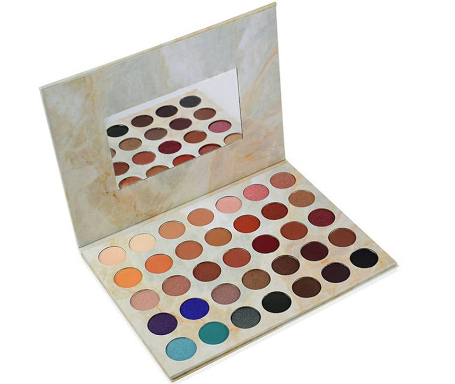 Our Posh Palette offers a luxurious variety of fabulous hues with shimmering toppers in glistening shades as well as a mixture of mattes. With richly-pigmented, easy-to-blend hues, you'll have endless possibilities to create a ton of different looks. From rich and bold to sophisticated and elegant. This palette does and has it all with versatility that lets you go for a subtle daytime look, and easily transition to a sultry night time smokey eye. It is the perfect go-to for creating a flawless, sexy look fo