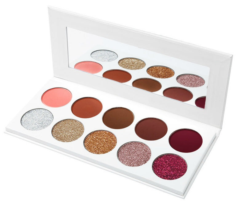 Available for Pre-Order today!  The Diva Glam Palette consist of 10 Color Pressed Glitter and Eyeshadow shades with Intense pigments. This eyeshadow is very easy to apply, made with 6x more pigment than other shadows and delivers a long lasting all day application!.The color dazzles in the light as it glistens across your eyelids and applies easily with consistency with a smooth fine texture. Great for that night out when you want to stand out in a crowd. With this palette your sure to make a statement. Eas