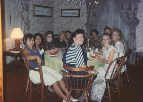 girls sitting around a table eating dinner 1992