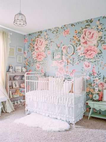 girls nursery with floral wall paper