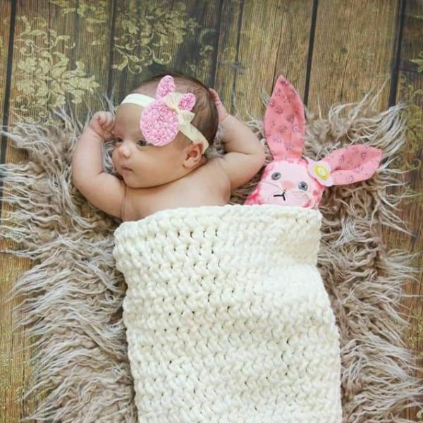 baby with tiny bunny next to her