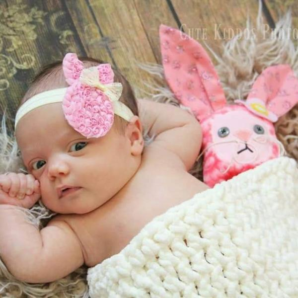 Baby with tiny bunny