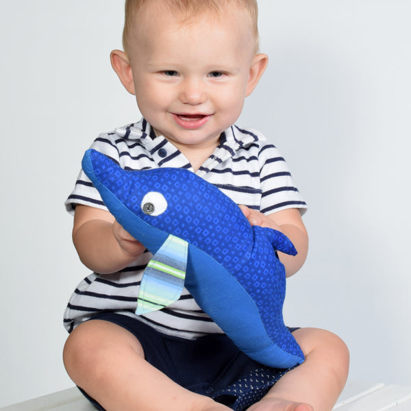 smiling baby with blue dolphin
