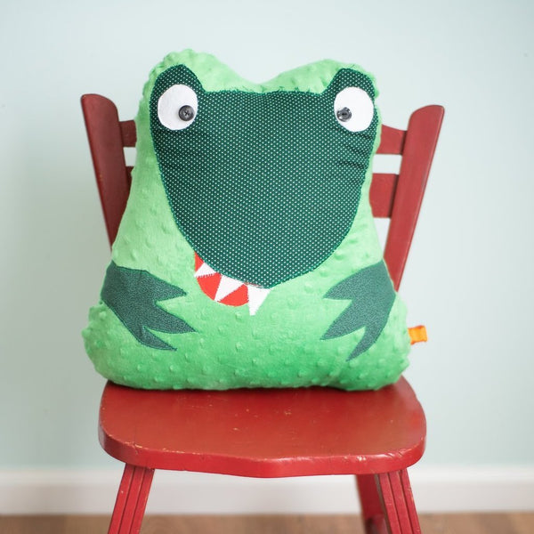 Dinosaur sitting on a chair