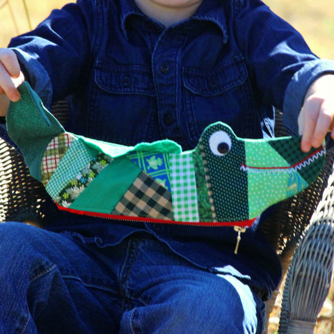Boy Holding an Alligator Pencil Case