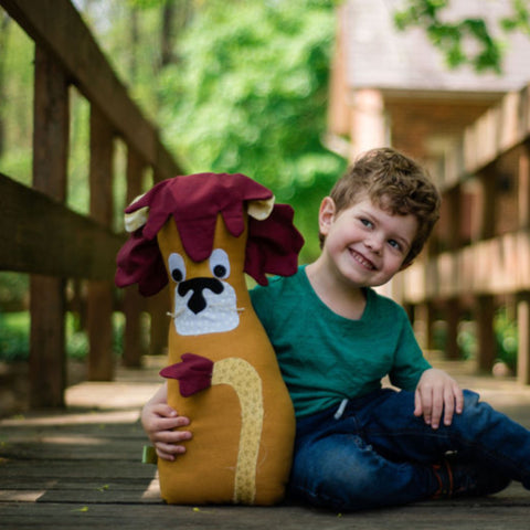 boy with lion stuffed animal