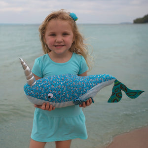 little girl with narwhal