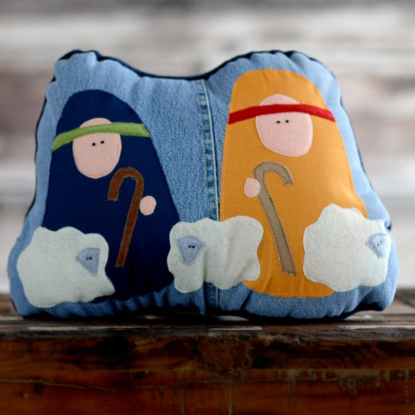 2 shepherds and their 3 sheep pillows in a nativity set